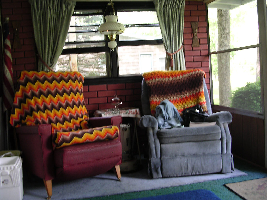 Two old, ugly recliners that have been handed down to the camp.