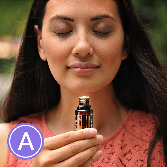 Woman inhaling orange essential oil