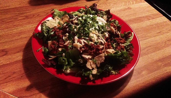 Venison Taco Salad On Red Plate
