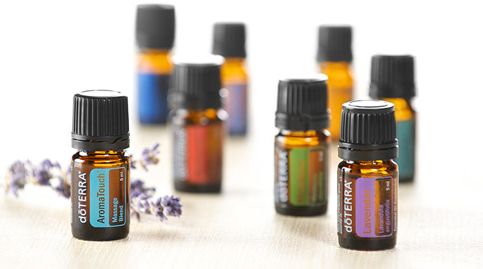 Essential oil bottles with a sprig of lavender