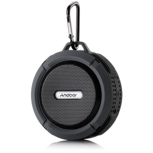 Round black speaker with carabiner