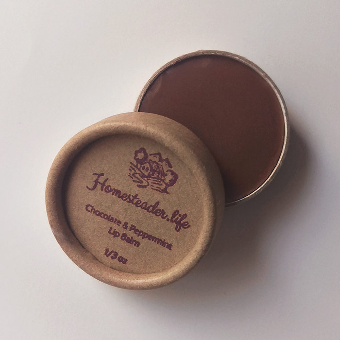 Chocolate And Peppermint Lip Balm In Kraft Container With Lid Overlapping Jar