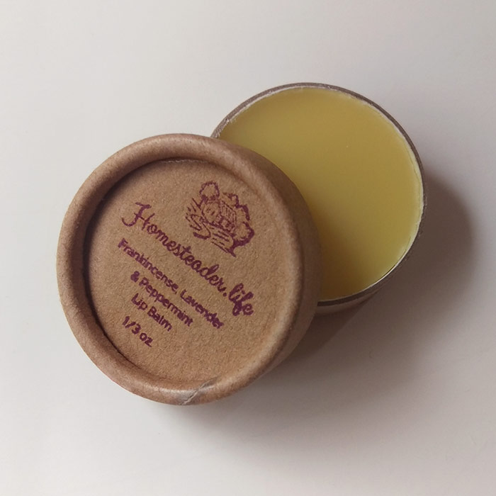Frankincense Lavender And Peppermint Lip Balm In Kraft Container With Lid Overlapping Jar