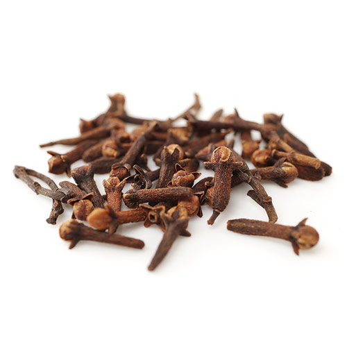 Small pile of cloves on white background